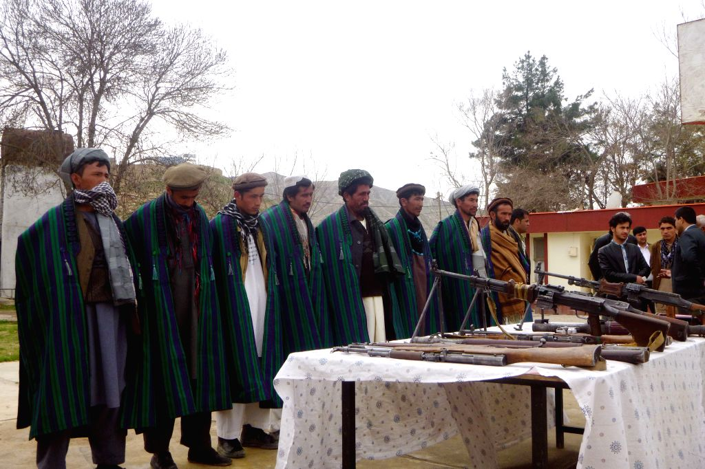 Taliban fighters attend a surrender ceremony in Baghlan province, north Afghanistan, March 26, 2015. Some 10 members of the Taliban insurgent group have ...