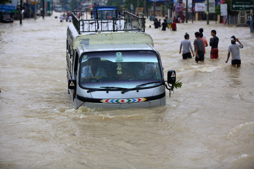 BAGO, July 28, 2018 - A truck wades through flood water in Bago Region, Myanmar, July 28, 2018. People in Bago Region are being affected by flood due to the continuous heavy rainfall.