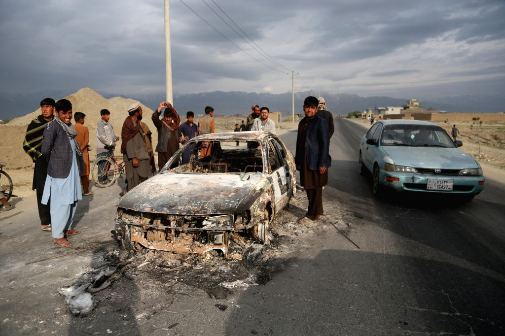 BAGRAM, April 9, 2019 - People gather at the site of an attack near the Bagram Air Base in Parwan province, Afghanistan, April 9, 2019. About five people, including three U.S. soldiers and a U.S. ...
