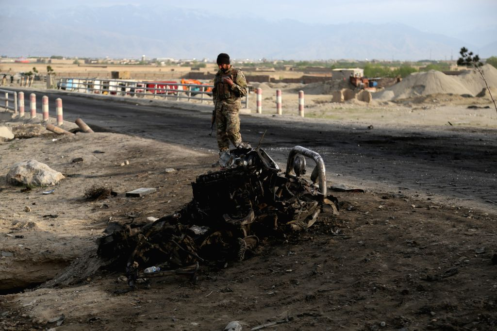 BAGRAM, April 9, 2019 (Xinhua) -- An Afghan security force member inspects the site of an attack near the Bagram Air Base in Parwan province, Afghanistan, April 9, 2019. About five people, including three U.S. soldiers and a U.S. contractor and an as