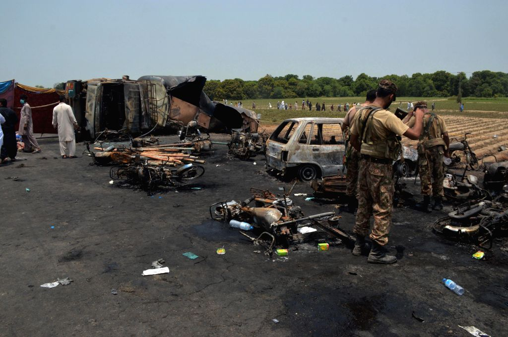 BAHAWALPUR, June 25, 2017 - Pakistani soldiers examine the oil tanker accident site in eastern Pakistan's Bawahalpur, on June 25, 2017. At least 140 people were killed and over 120 others injured in ...