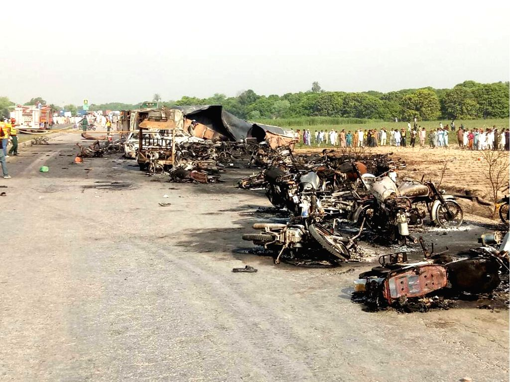 BAHAWALPUR, June 25, 2017 - Photo taken with a mobile phone shows burnout vehicles at the accident site in east Pakistan's Baahawalpur, a district in Punjab, on June 25, 2017. At least 120 people ...