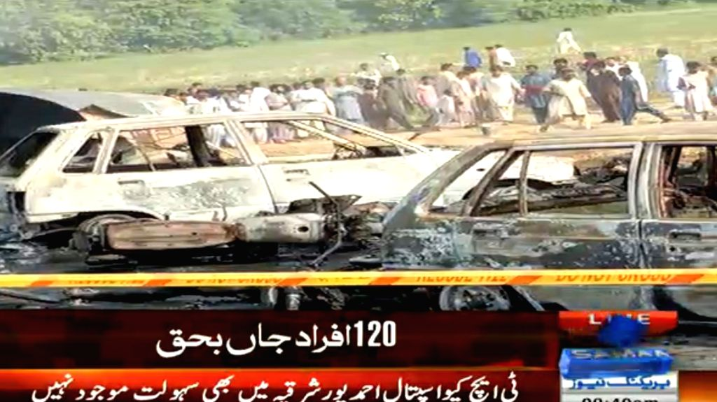 BAHAWALPUR, June 25, 2017 - TV grab taken on June 25, 2017 from Samma News shows locals gathering near the burnout vehicles at the accident site in east Pakistan's Baahawalpur, a district in Punjab. ...