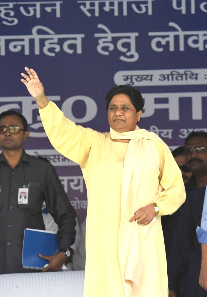 Bahujan Samaj Party (BSP) chief Mayawati waves at supporters during a public rally in New Delhi, on May 10, 2019.