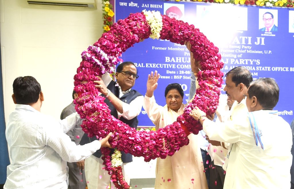 Bahujan Samaj Party chief Mayawati being garlanded after being re-elected as party President at the party's headquarters in Lucknow, on Aug 28, 2019.