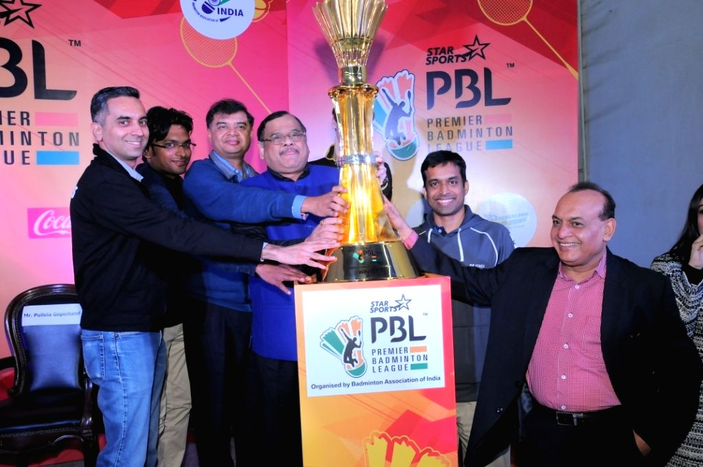 BAI president and PBL chairman Dr Akhilesh Das Gupta  and Indian badminton team`s chief coach Pullela Gopichand during the trophy unveiling ceremony of Premier Badminton League (PBL) - ... - Akhilesh Das Gupta