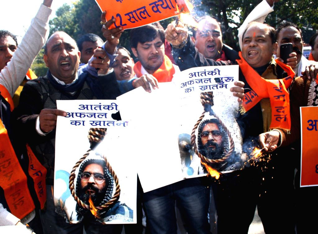 Bajrang Dal activists celebrate hanging of Afzal Guru at Jantar Manter in New Delhi 09 Feb 2013.