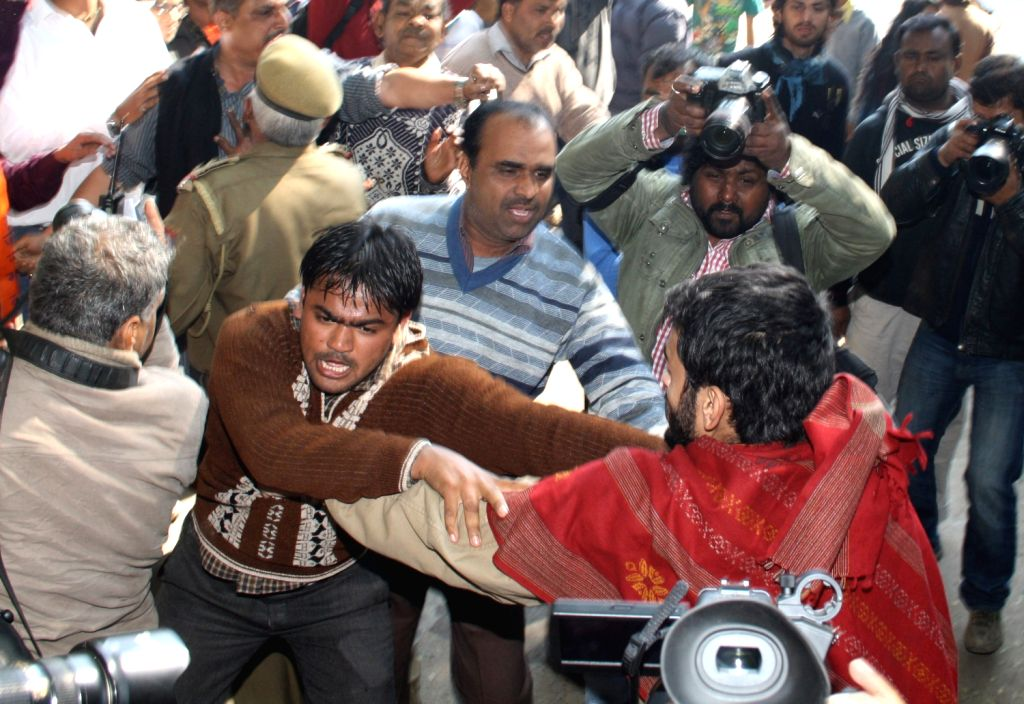 Bajrang Dal activists clash with group of students protesting against Afzal Guru's hanging at Jantar Manter in New Delhi 09 Feb 2013.