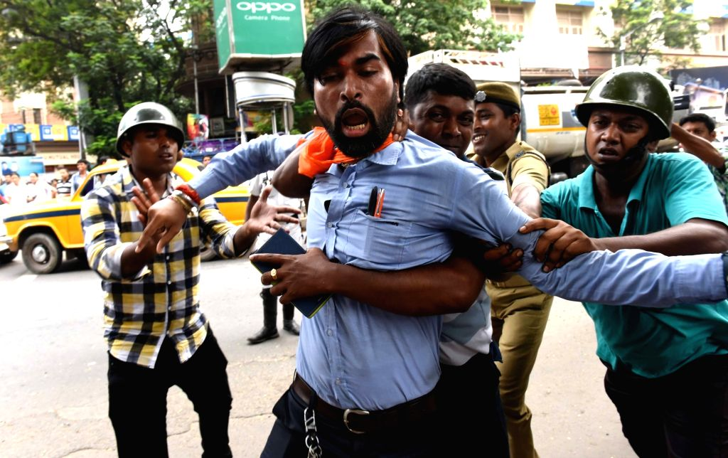Bajrang Dal activists stage a demonstration against a media house in Kolkata on Aug 10, 2017.