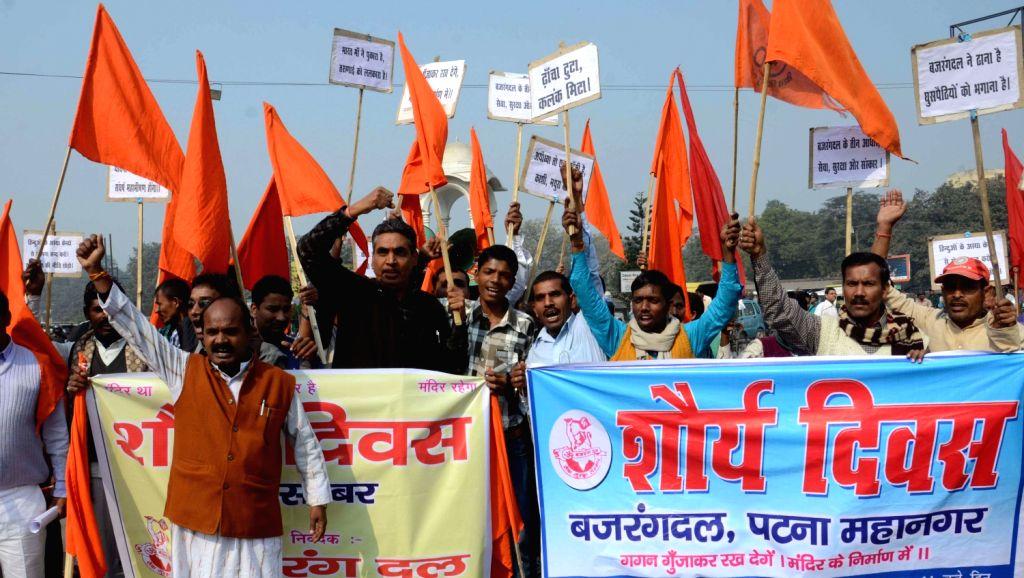 Bajrang Dal workers stage a demonstration at Kargil Chowk in Patna on Dec. 6, 2013.