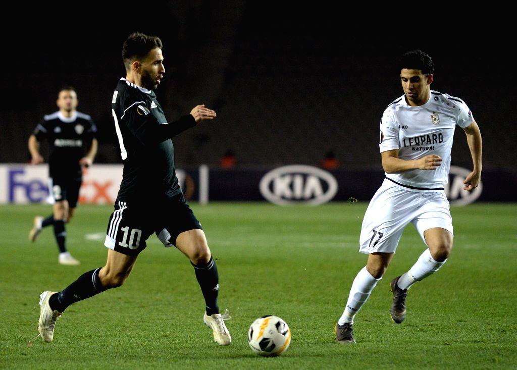 BAKU, Dec. 13, 2019 - Dani Quintana (L) of Azerbaijan's Qarabag competes during a UEFA Europa League Group A match between Azerbaijan's Qarabag and Luxembourg's Dudelange in Baku, Azerbaijan, Dec 12, ...