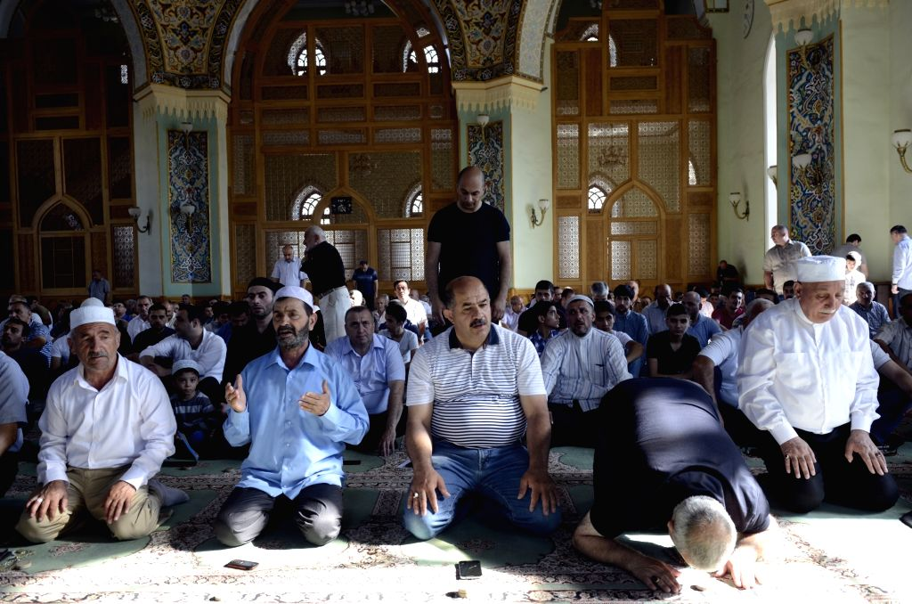 BAKU, June 26, 2017 - Muslims pray in a mosque to celebrate the Eid al-Fitr marking the end of the holy fasting month of Ramadan in Baku, Azerbaijan, June 26, 2017.