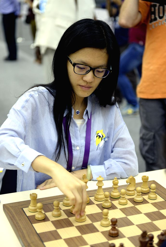 BAKU, Sept. 14, 2016 - Hou Yifan of China competes during the last round of the World Chess Olympiad against Russia in Baku, Azerbaijan, Sept. 13, 2016. China claimed the title after defeating Russia ...