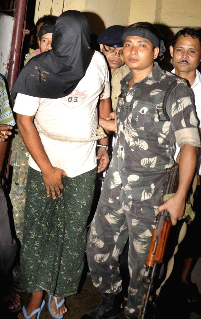 Bakul Sheikh being taken to be produced at a Kolkata court  on Aug 14, 2016. - Bakul Sheikh