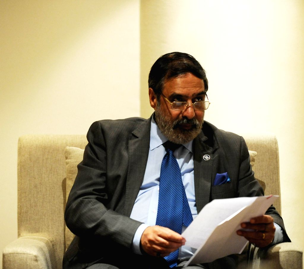 India's Minister of Commerce and Industry Anand Sharma briefs the Indian delegates after agreeing a draft package during the ninth ministerial meeting of ... - Anand Sharma