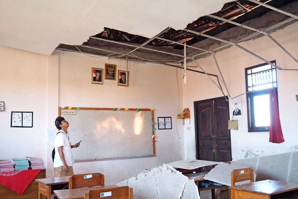 BALI, July 16, 2019 - An elementary school teacher examines a damaged classroom after an earthquake in Nusa Dua, Bali, Indonesia, July 16, 2019. An earthquake of 6.0 magnitude struck off Indonesia's ...
