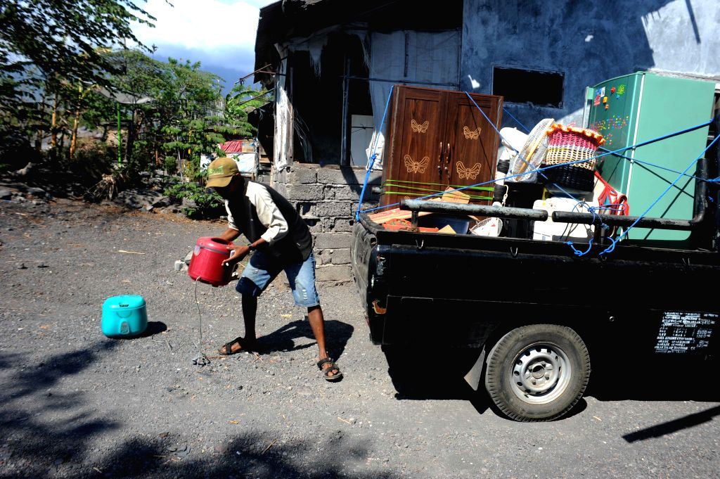 BALI, Sept. 30, 2017 - A man moves his houseware into a truck from his house as he leaves during the evacuation at Kubu village, in Karangasem, Bali, Indonesia, on Sept. 30, 2017. The number of ...