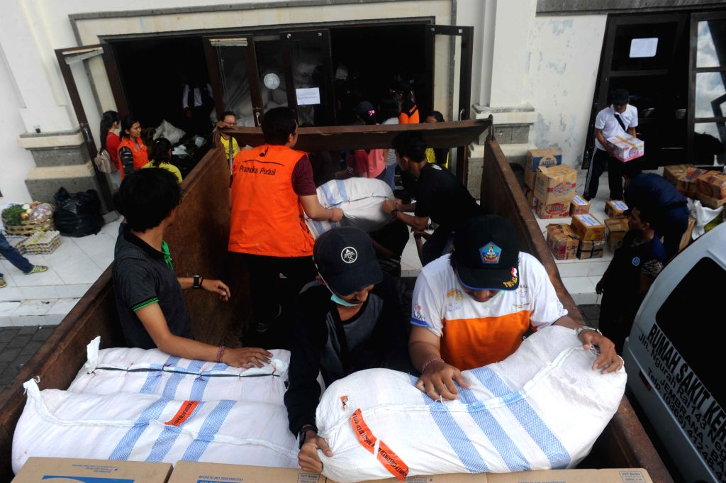 BALI, Sept. 30, 2017 - Volunteers prepare relief supplies in Karangasem, Bali, Indonesia, on Sept. 30, 2017. The number of people escaping rumbling Bali volcano has risen to nearly 144,000 and the ...