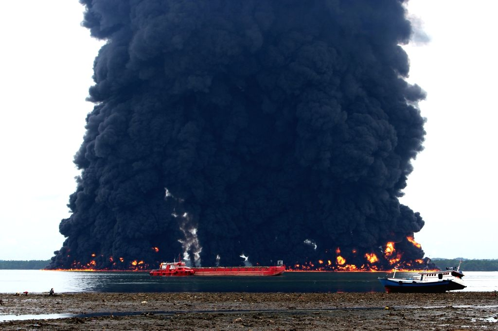 BALIKPAPAN, March 31, 2018 - Black smoke rises from a burned oil spill at the waters in Balikpapan, Indonesia, March 31, 2018. A cargo ship caught fire in waters off East Kalimantan province in ...