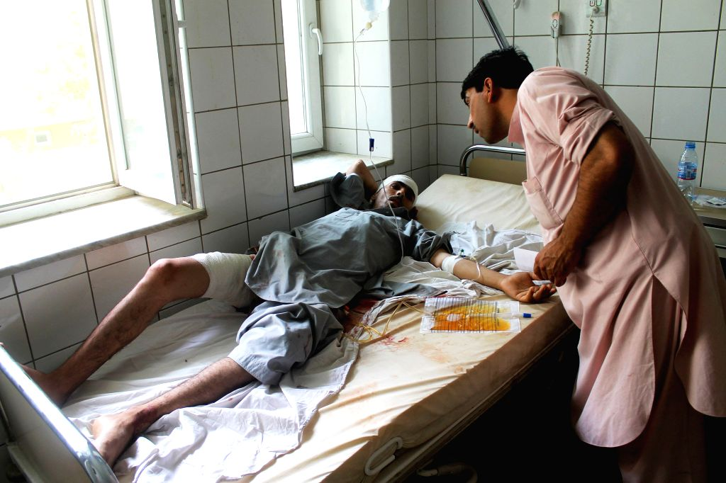A wounded Afghan man receives treatment at a hospital in Balkh province of Afghanistan on June 16, 2014.  A powerful blast rocked Mazar-e-Sharif city, capital of ...