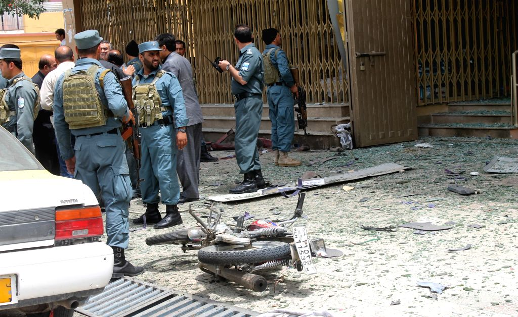 Afghan security forces inspect the site of a blast in Balkh province of Afghanistan on June 16, 2014.  A powerful blast rocked Mazar-e-Sharif city, capital of ...