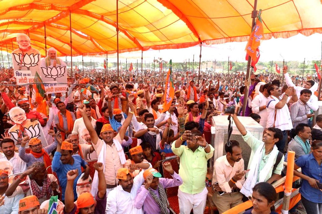 Ballia: Supporters during BJP chief Amit Shah's rally in Sikandarpur, Ballia of Uttar Pradesh on May 16, 2019. (Photo: IANS/Amit Shah) - Amit Shah