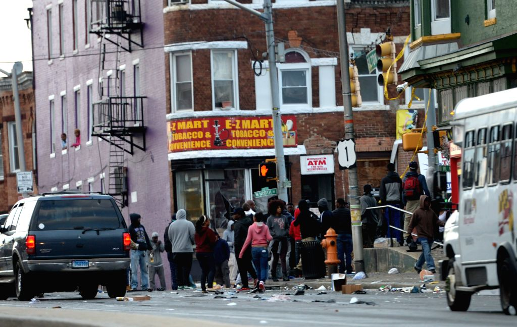 A store is looted in Baltimore, Maryland, the United States, April 27, 2015. Maryland governor Larry Hogan Monday evening declared a state of emergency and ...