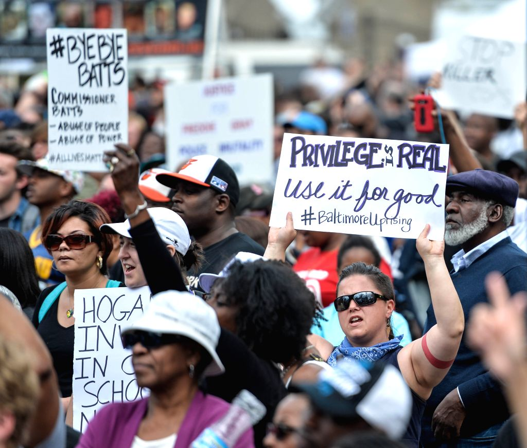 People attend a rally in front of the City Hall in Baltimore, Maryland, the United States, May 2, 2015. Thousands of people in Baltimore, the largest city in U.S. ...