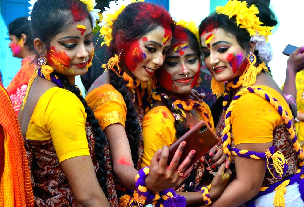 "Balurghat : Girls take a selfie while celebrating Holi festival during ""Basanta Utsav"" at Balurghat in South Dinajpur district of West Bengal on March 12, 2017."