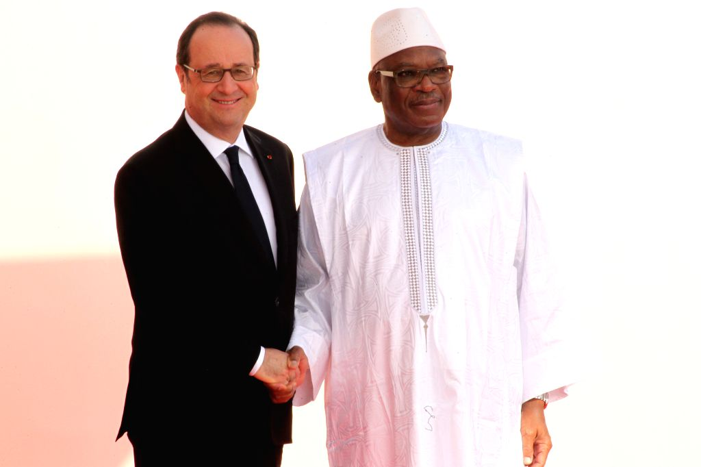BAMAKO, Jan. 14, 2017 - French President Francois Hollande (L) shakes hands with Malian President Ibrahim Boubacar Keita prior to the opening ceremony of the 27th Africa-France Summit in Bamako, ...