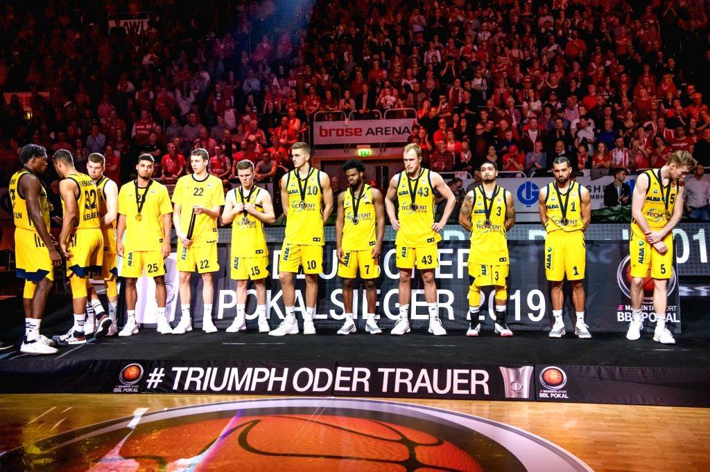 BAMBERG, Feb. 18, 2019 - Alba Berlin's players react during the awarding ceremony of the final match of German Cup between Brose Bamberg and Alba Berlin, in Bamberg, Germany, on Feb. 17, 2019. Brose ...