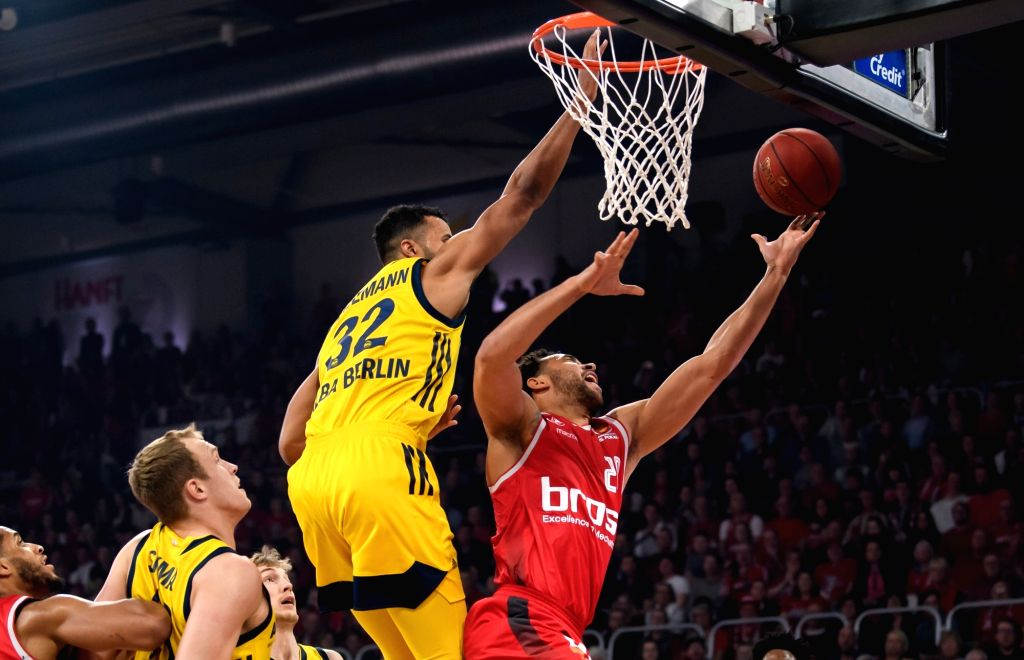 BAMBERG, Feb. 18, 2019 - Brose Bamberg's Elias Harris (R) goes to basket during the final match of German Cup between Brose Bamberg and Alba Berlin, in Bamberg, Germany, on Feb. 17, 2019. Brose ...
