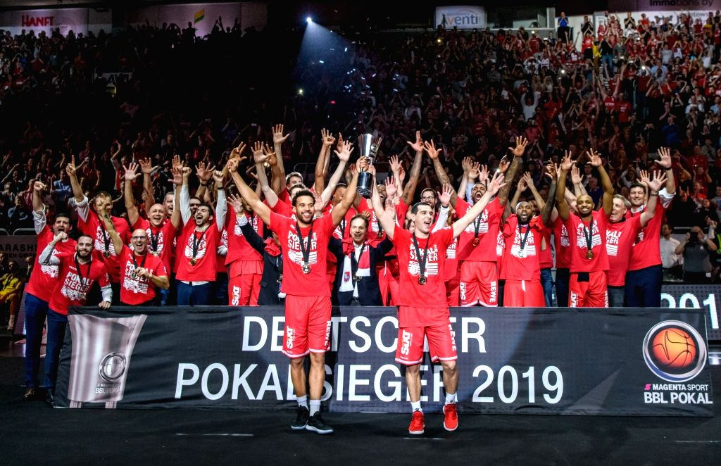BAMBERG, Feb. 18, 2019 - Brose Bamberg's players celebrate after the final match of German Cup between Brose Bamberg and Alba Berlin, in Bamberg, Germany, on Feb. 17, 2019. Brose Bamberg claimed the ...
