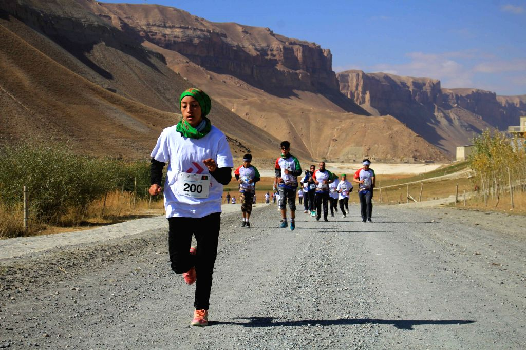 BAMIYAN, Oct. 12, 2019 - Athletes compete during a marathon race at Band-e-Amire park in Bamiyan province,central  Afghanistan, Oct. 11, 2019.