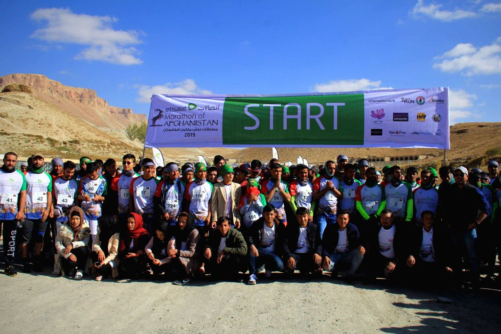 BAMIYAN, Oct. 12, 2019 - Athletes pose for photos before a marathon race at Band-e-Amire park in Bamiyan province,central  Afghanistan, Oct. 11, 2019.