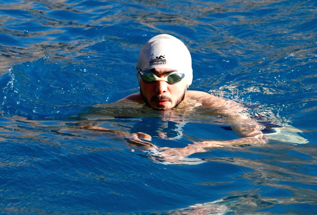 BAMYAN, Aug. 5, 2017 - An Afghan man take part in a swimming competition in Bamyan province, Afghanistan, Aug. 4, 2017. Around 100 swimmers from six provinces participate in this competition at ...