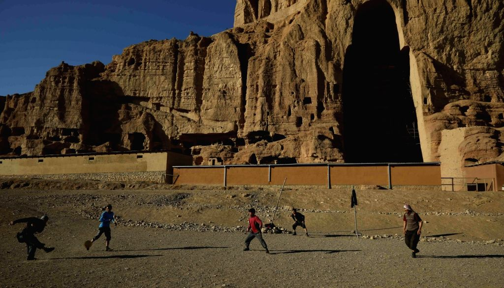 BAMYAN, Dec. 12, 2018 - People play football in front of the ruined Buddha in Bamyan province, central Afghanistan, Dec. 11, 2018. Bamyan was once a major tourist destination and prosperous town in ...