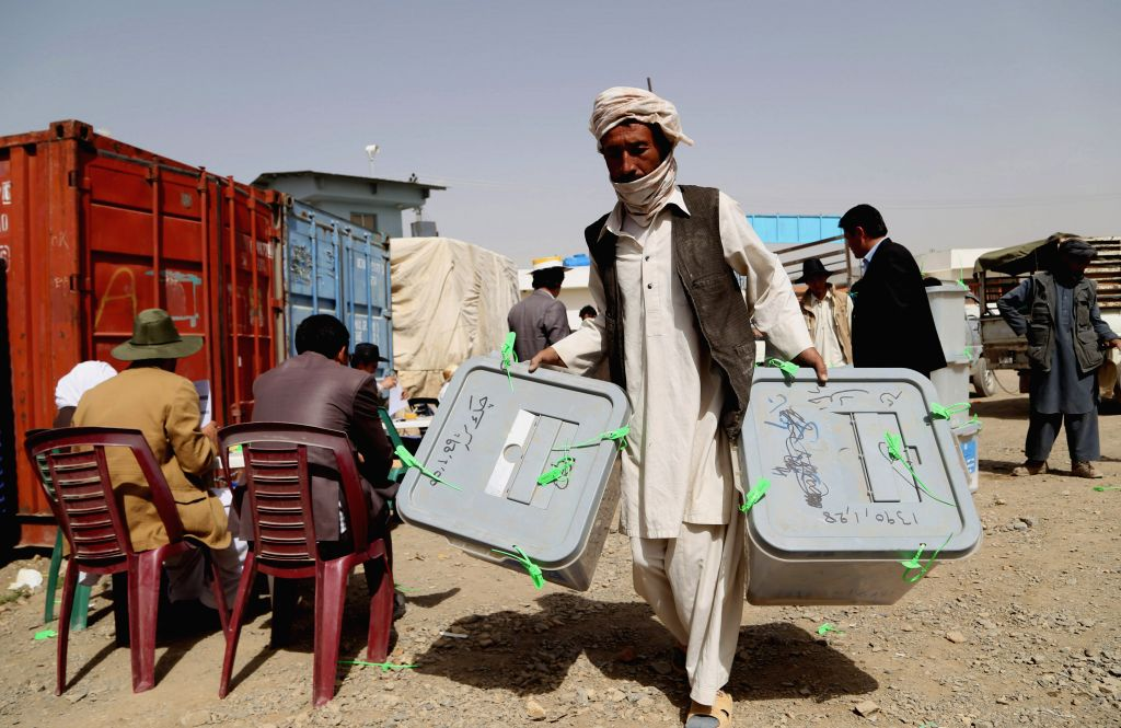 Afghan election commission workers carry ballot boxes for counting in Bamyan province, central Afghanistan June 16, 2014.