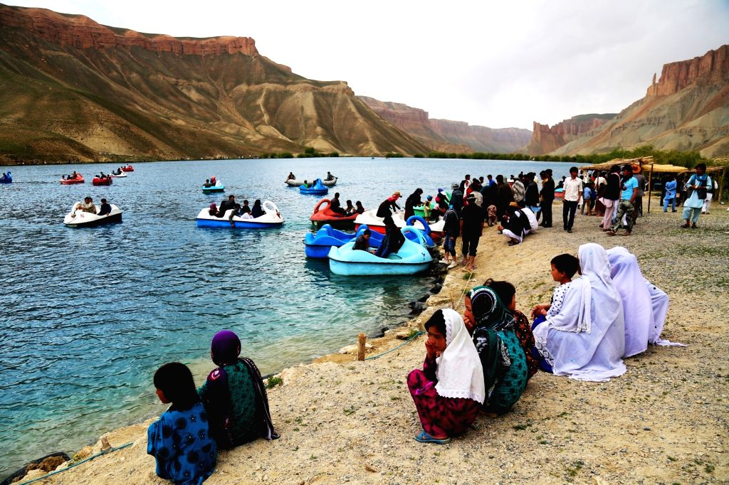 BAMYAN, June 4, 2016 - Afghans gather around the Band-e-Amir lake in Bamyan province, central Afghanistan, on June 3, 2016. Band-e-Amir lake was recognized as Afghanistan's first national park in ...