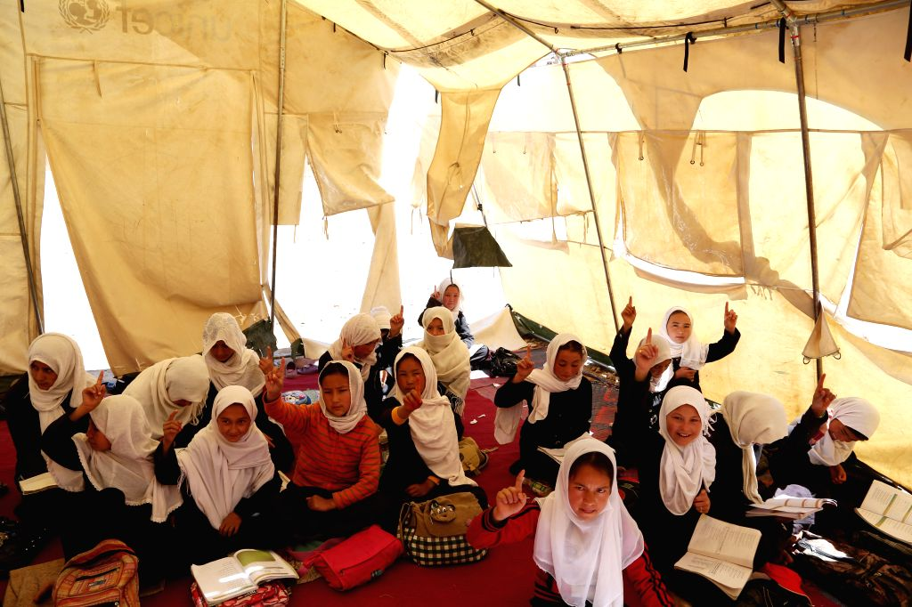 , 2014 Afghan children attend their class at a school in Bamyan province in central Afghanistan on May 13, 2014.