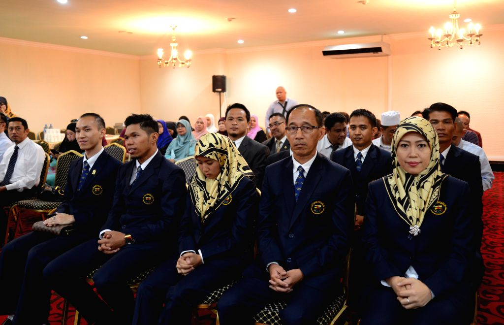 BANDAR SERI BEGAWAN, Aug. 1, 2016 Xinhua)Photo taken on Aug. 1, 2016 shows members of an eight people Olympic delegation at a ceremony at Hassanal Bolkiah Stadium to present the national flag in ...
