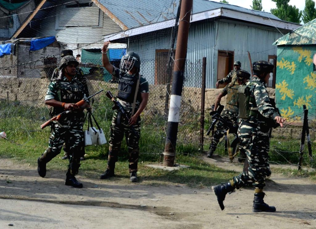 Bandipora: Soldiers in action after four foreign terrorists attacked a CRPF camp in Jammu and Kashmir's Bandipora district on June 5, 2017. All the four terrorists were shot dead by the troopers and police after an hour-long battle. (Photo: IANS)