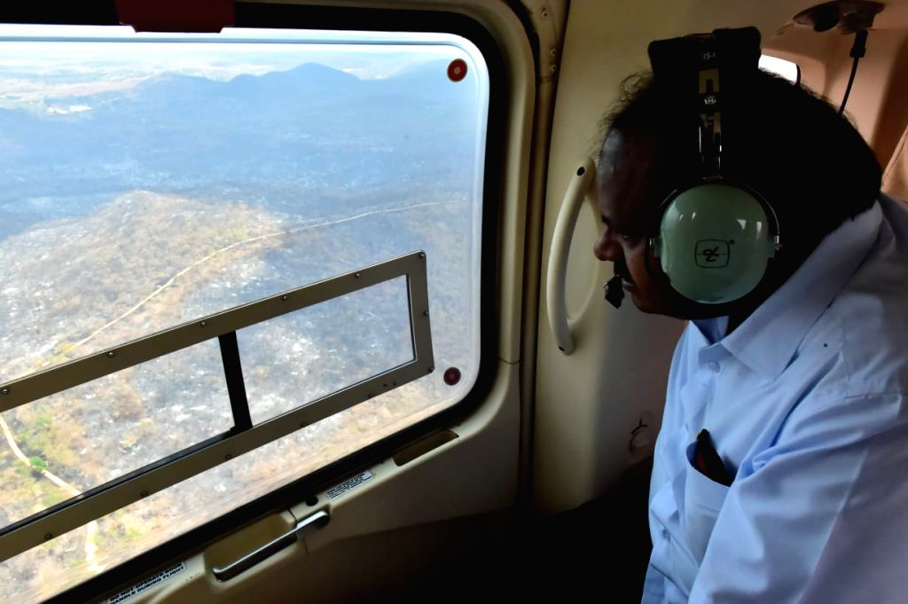 Bandipur: Karnataka Chief Minister H.D. Kumaraswamy conducts an aerial survey of the Bandipur National Park after the raging forest fire there was brought under control; on Feb 27, 2019. (Photo: IANS) - H.