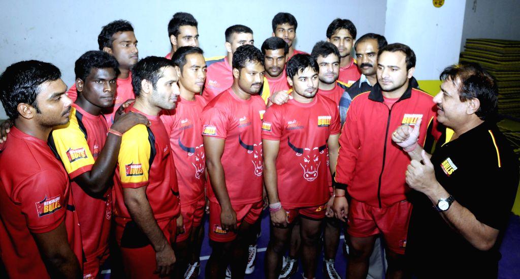 Bangalore Bulls kabaddi team members practice with coach Randhir Singh ahead of the Pro Kabbadi League matches in Bangalore on Aug. 23, 2014.