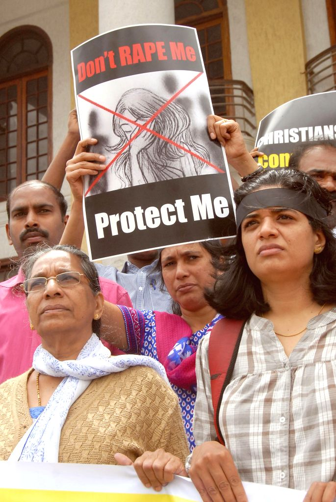 Bangalore Christian community protest condemning Rape and atrocities on women, expressing their solidarity against the Victims, demanding stringent punishment to Rapists in Bangalore on July 24, ...