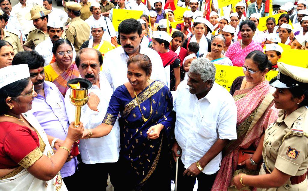 Bangalore Mayor B S Satyanarayana and Deputy Mayor Indira participate in `Nirbheeti` awareness rally in Bangalore on Aug 22, 2014.