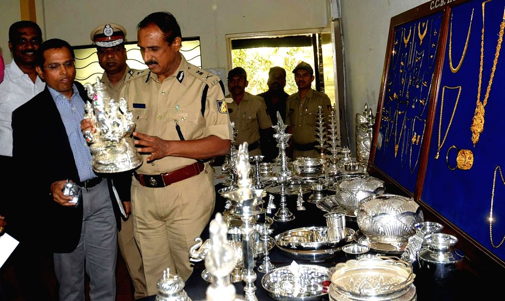 Bangalore Police Commissioner Jyothi Prakash Mirji and other police officers inspecting recovered jewels and silver items which were recovered by CCB police personnel from the thieves during the ...