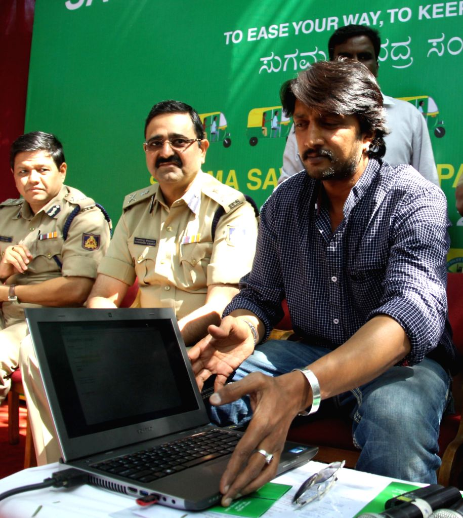 Bangalore Police Commissioner Raghavendra Auradkar and actor Sudeep during launch of `Sugama Savari` - an awareness programme targeted at auto drivers organised by Bangalore City Traffic Police in ...