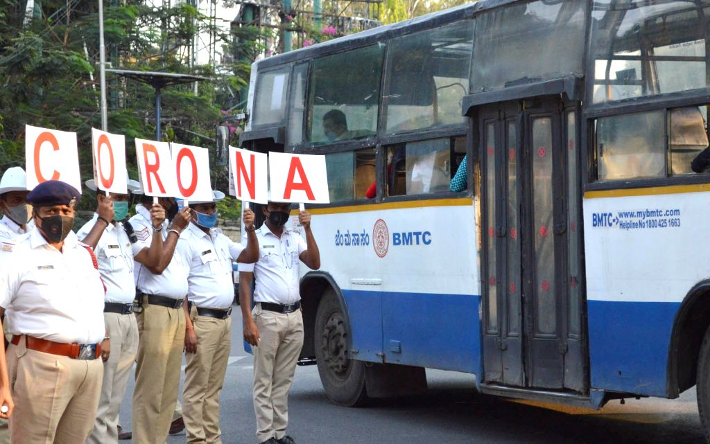 Bangalore Traffic police conducted a awareness campaign on ahead of Sunday's nationwide 'Janata Curfew' imposed in the wake of increasing number of cases of COVID-19 (coronavirus), in ...