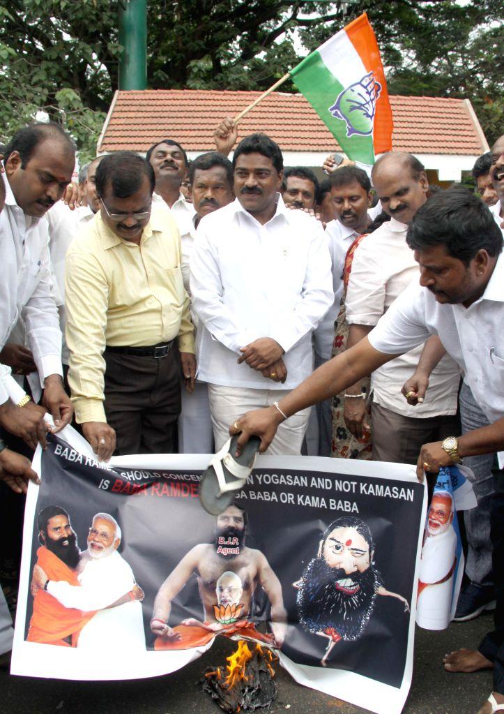 Bangalore Youth Congress members demonstrate against Yoga guru Ramdev for his anti-dalit remark, in Bangalore on April 28, 2014.